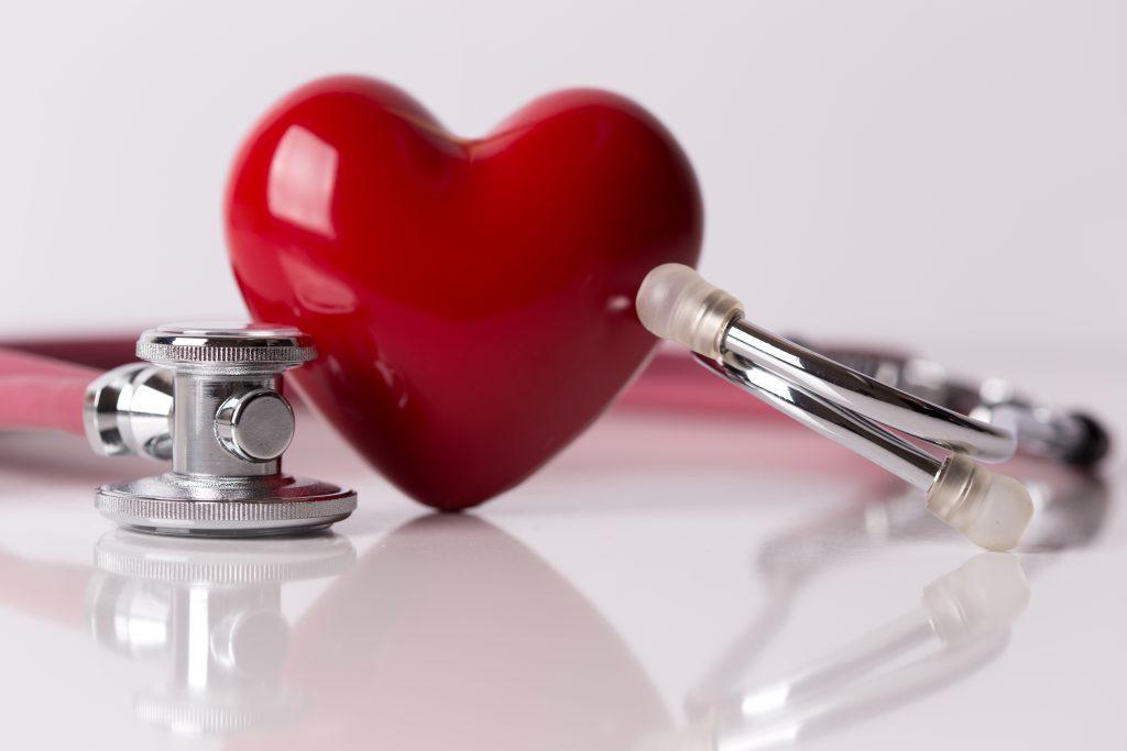 Stethoscope beside a ceramic heart