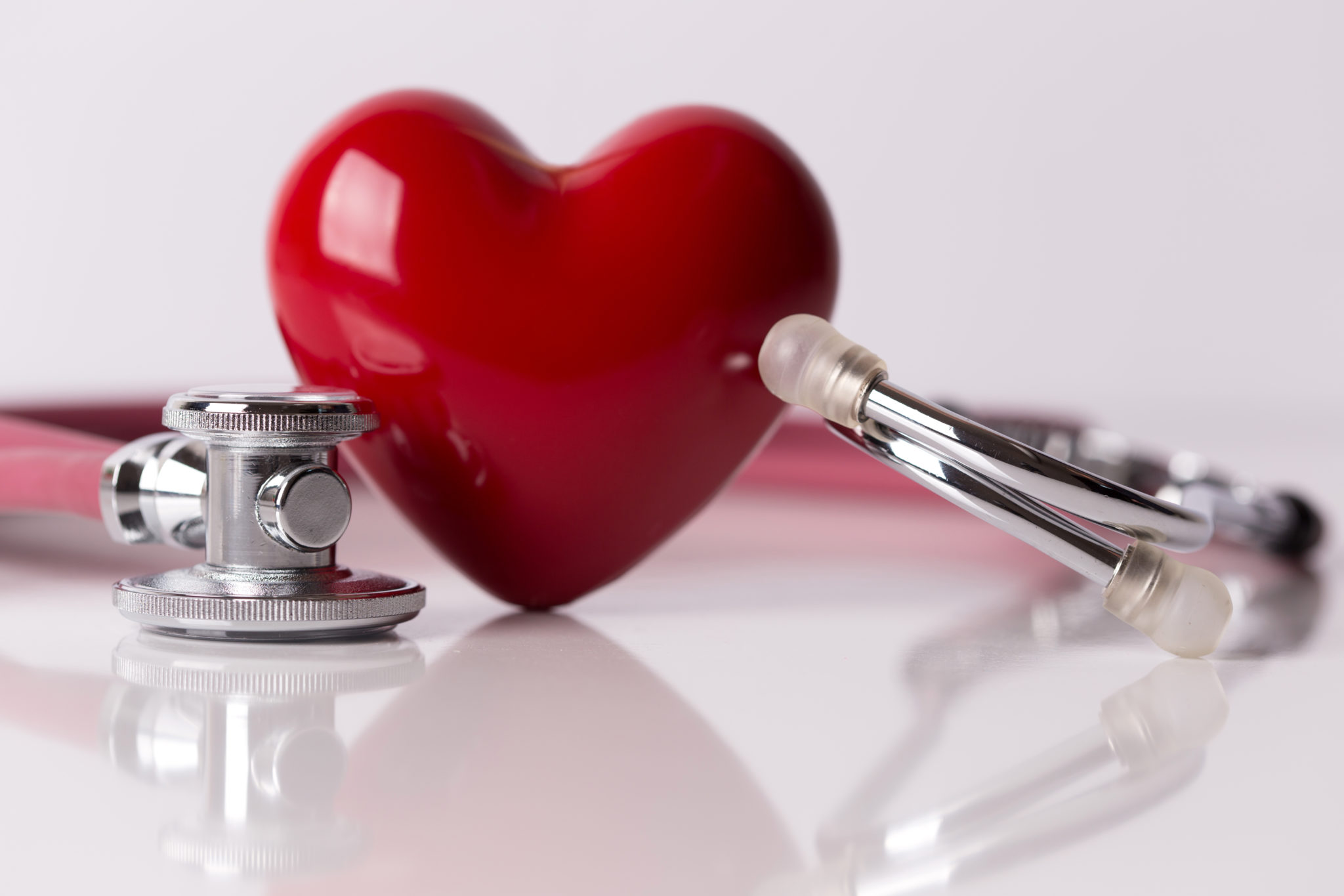 Stethoscope beside a ceramic heart