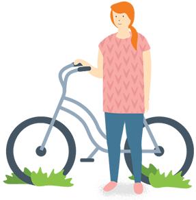 Woman standing next to a bicycle on grass