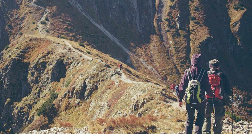 Image of people hiking on mountain top trails