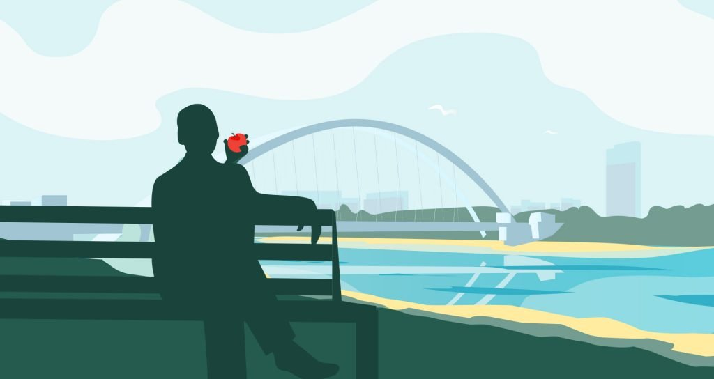 Man holding up an apple while sitting on a bench, depicting the thought of making the most of a situation
