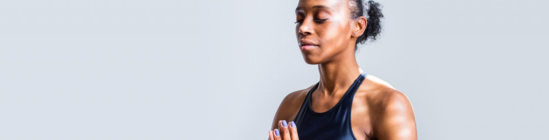 woman meditating in black shirt