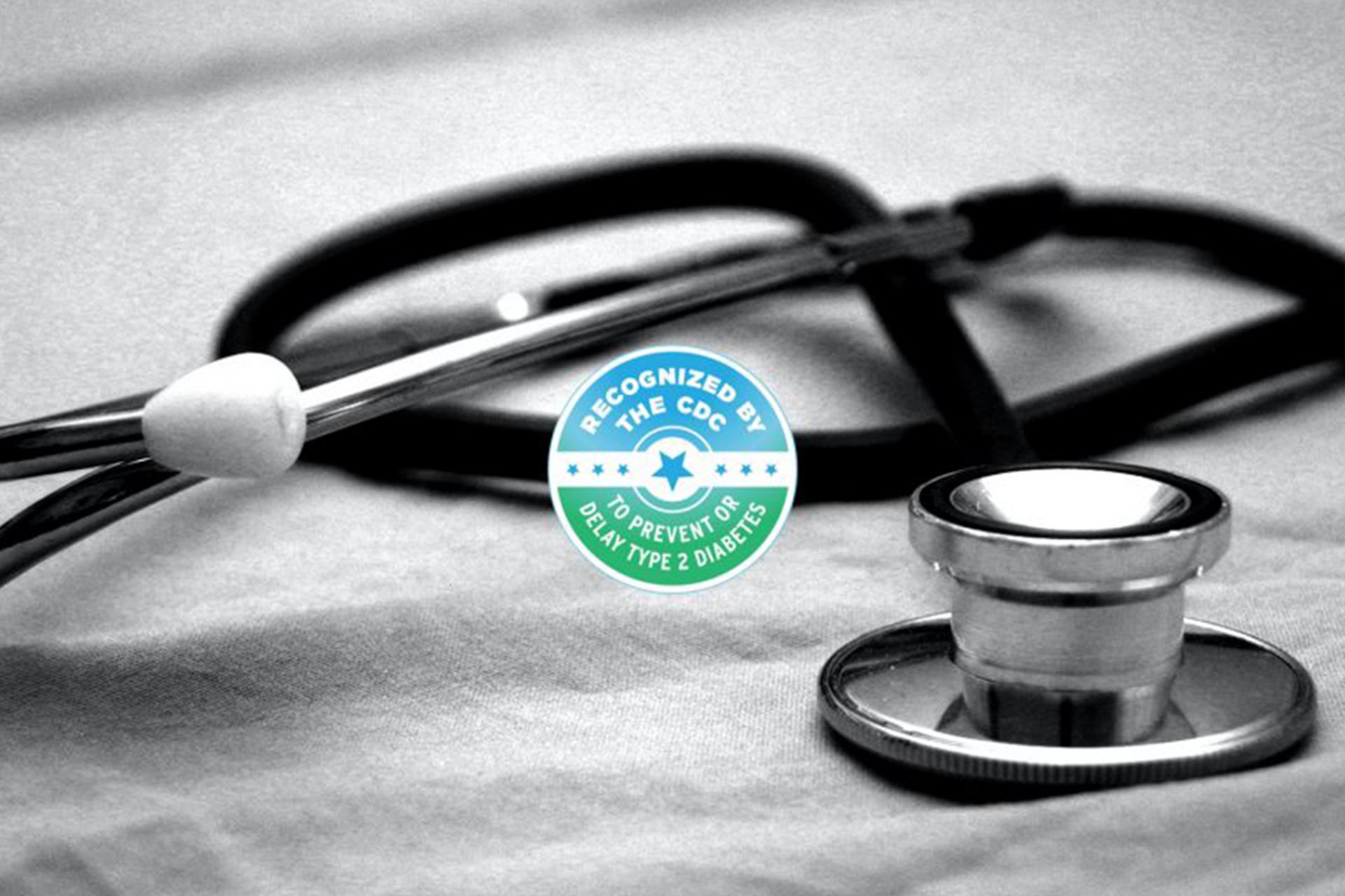 A stethoscope beside the CDC logo