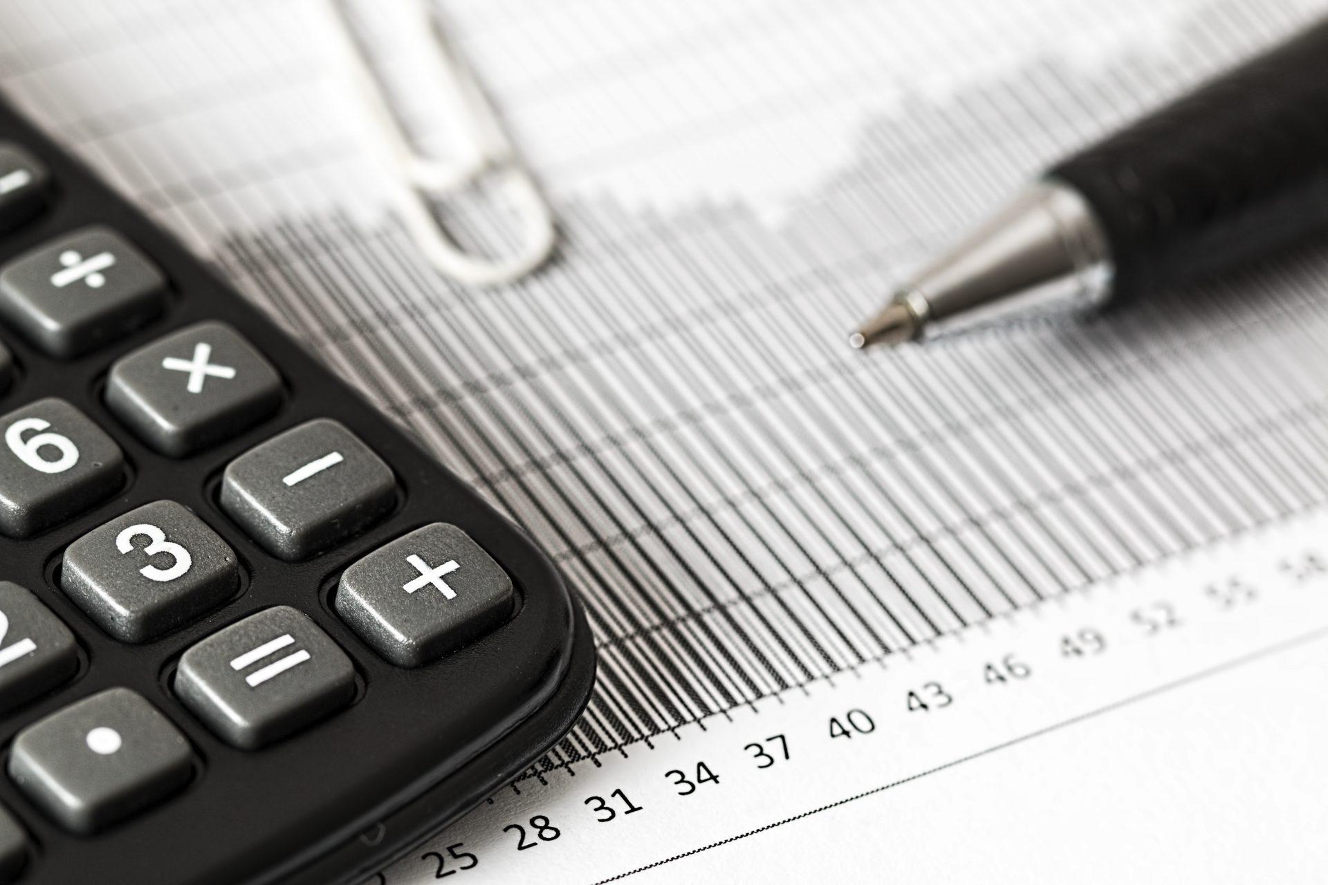a calculator, graph, and pen