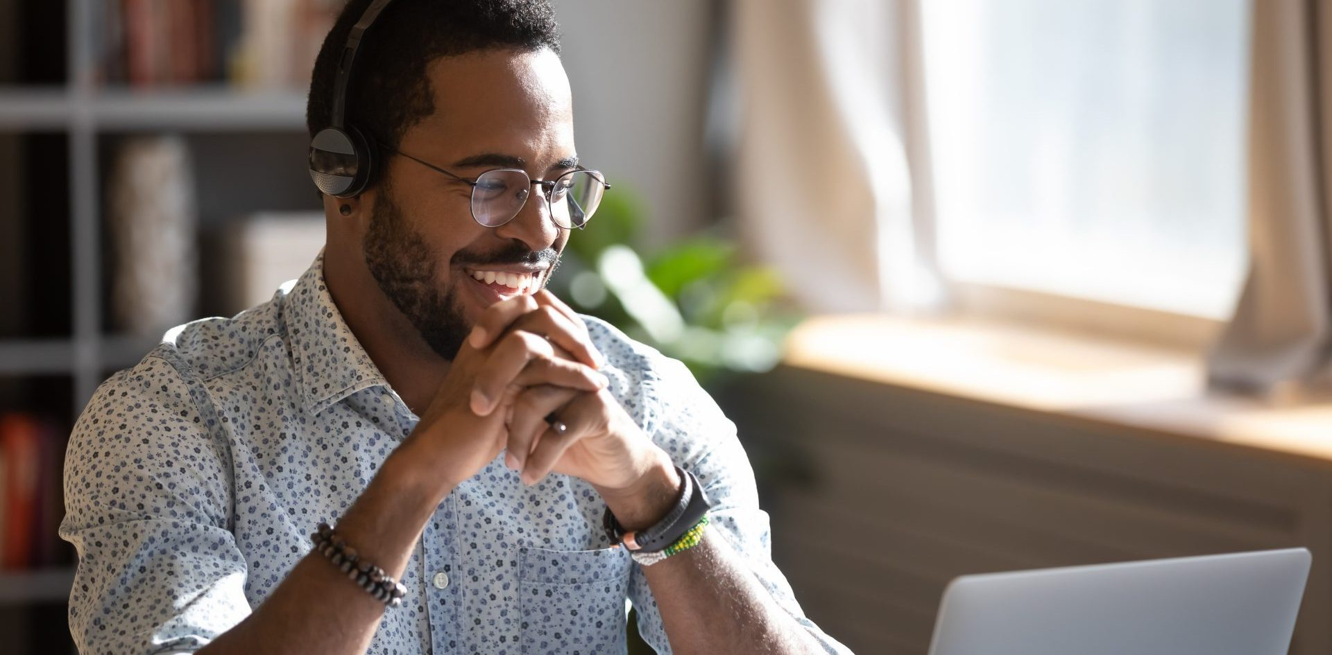 person with headphones on laughing