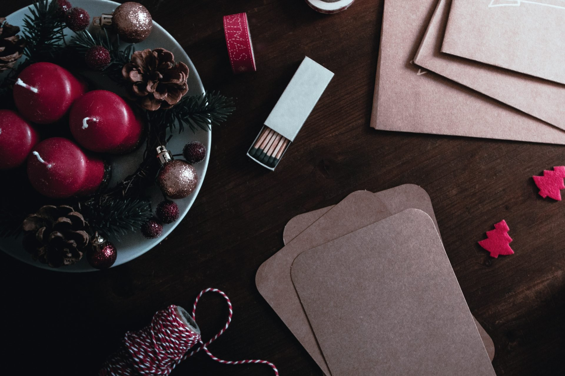 candles, matches, and wrapping paper supplies on a wooden table
