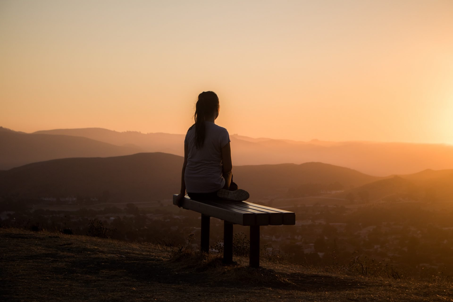 woman looking at the vista as the sun rises