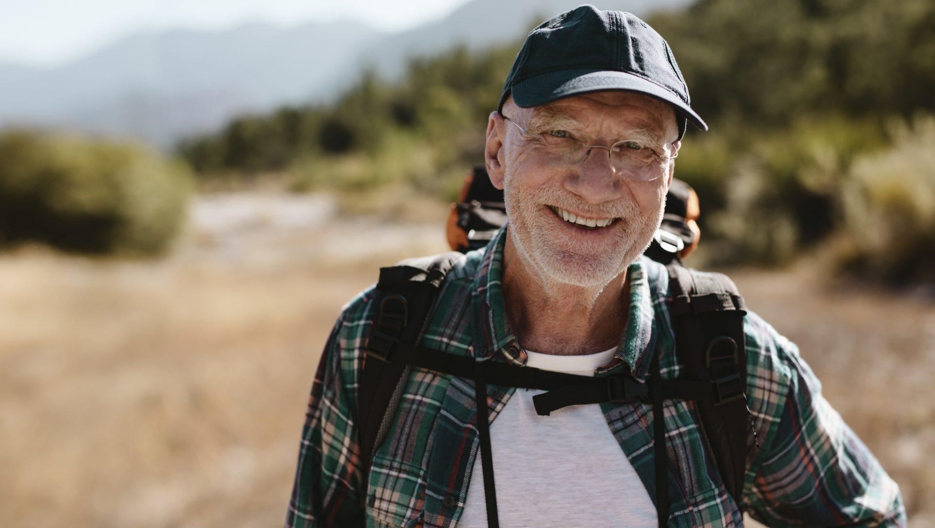 Senior man hiking to reduce disease risk